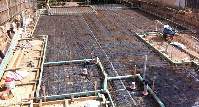 Reinforcement details for slabs-on-ground with crack control factors