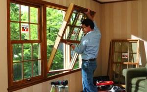 Man Replacing Windows in Home