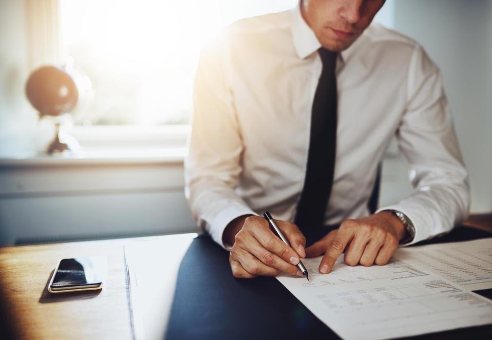 Man reviewing paperwork