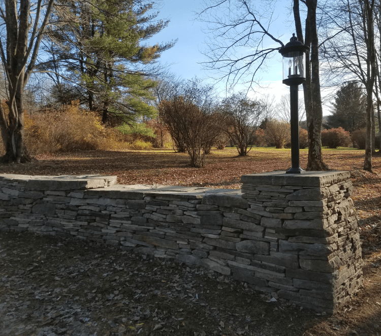After photo of a stone wall