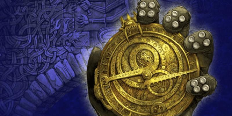 Imagem que ilustra o livro Caçadores de Trolls. Na imagem, uma mão enluvada segura um objeto redondo e dourado que parece ser uma bússola.
