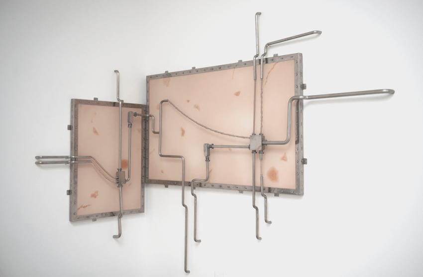 Dora Budor, The Architect,...(number 6) (2015). SFX transfer scars from the movie 300: Rise of an Empire, silicone sheet, silicone cast wiring, electrical fittings, stainless steel, and assorted metal hardware, 76.5 x 122.5 inches. Image courtesy of the artist and Various Small Fires.