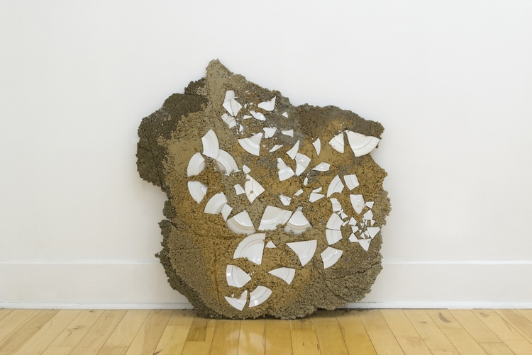 "Elif Erkan, Grounded (2015). Concrete, fiberglass, pigments, china and gold plates, 36"" x 35.5"" x 3"". Image courtesy of the artist and Park View."