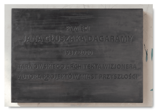 "Rafał Bujnowski, The plaque commemorating Jan Głuszak ""Dagarama"", brass, heating system, 2011, (photo Mateusz Sadowski, archives of BWA in Tarnów)"