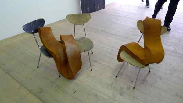 Olaf Brzeski, Little Orphans series, 2009-2014, left side: Untitled, 2014, cast iron, chairs, 74 x 94 x 67 cm right side: Untitled, 2014, cast iron, chairs, 84 × 66 × 48 cm Raster Gallery, Booth 0/10/1, photo Andrzej Szczepaniak for Contemporary Lynx