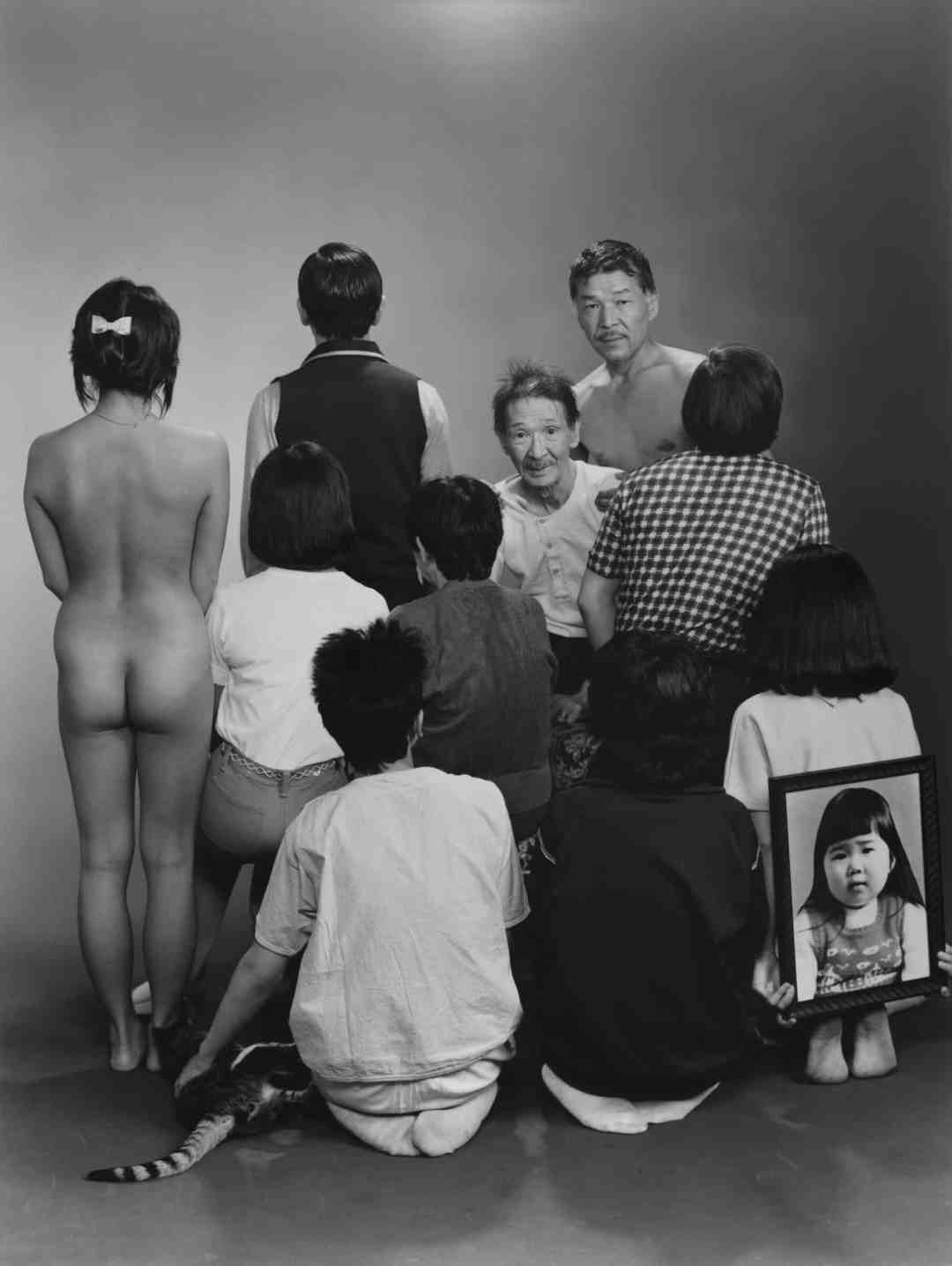 "Masahisa Fukase. Upper row, from left to right: A, a model; Toshiteru, Sukezo, Masahisa. Middle row, from left to right: Akiko, Mitsue, Hisashi Daikoji. Bottom row, from left to right: Gaku, Kyoko, Kanako, and a memorial portrait of Miyako, 1985, from the series ""Family"" (1971-90) © Masahisa Fukase Archives"