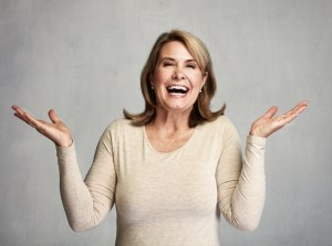 mature woman happy with arms up