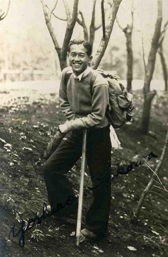 young asian american man hiking 1930s