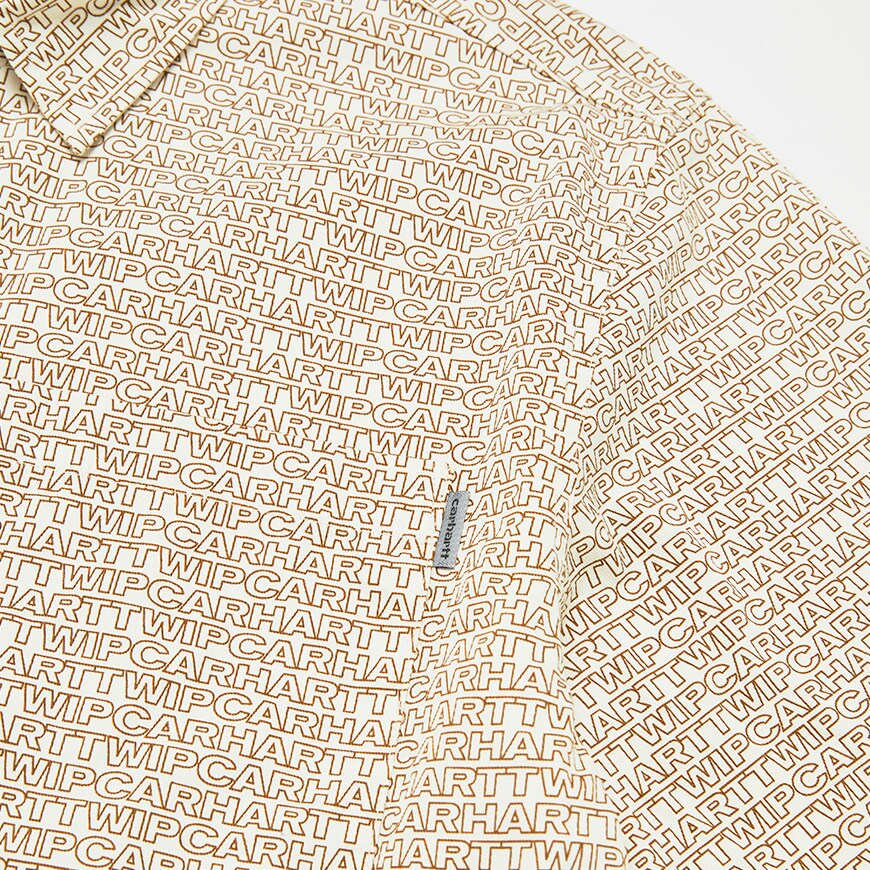 A picture of a shirt by Carhartt WIP featuring an all-over logo print. Available at ASOS.