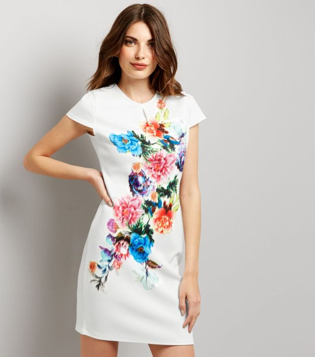 model wearing New Look white floral dress