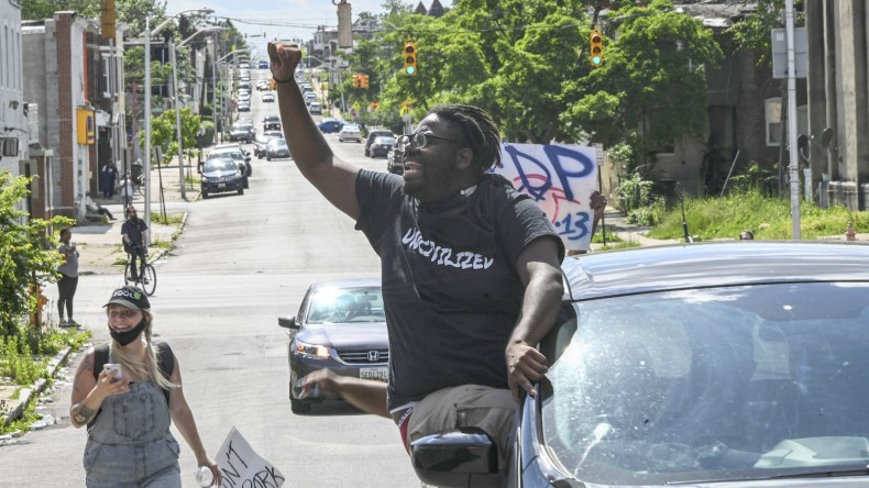 Protesters drive through West Baltimore. (J.M. Giordano)