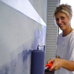 a homeowner painting the walls