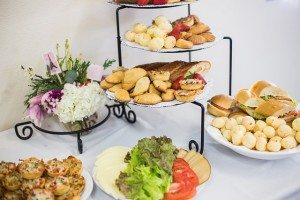 appetizers on raised food stands