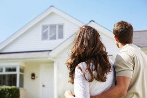 potential buyers staring at a house