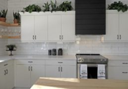 White cabinets in a large open kitchen.