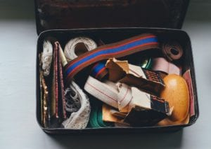 A suitcase filled with random belongings.
