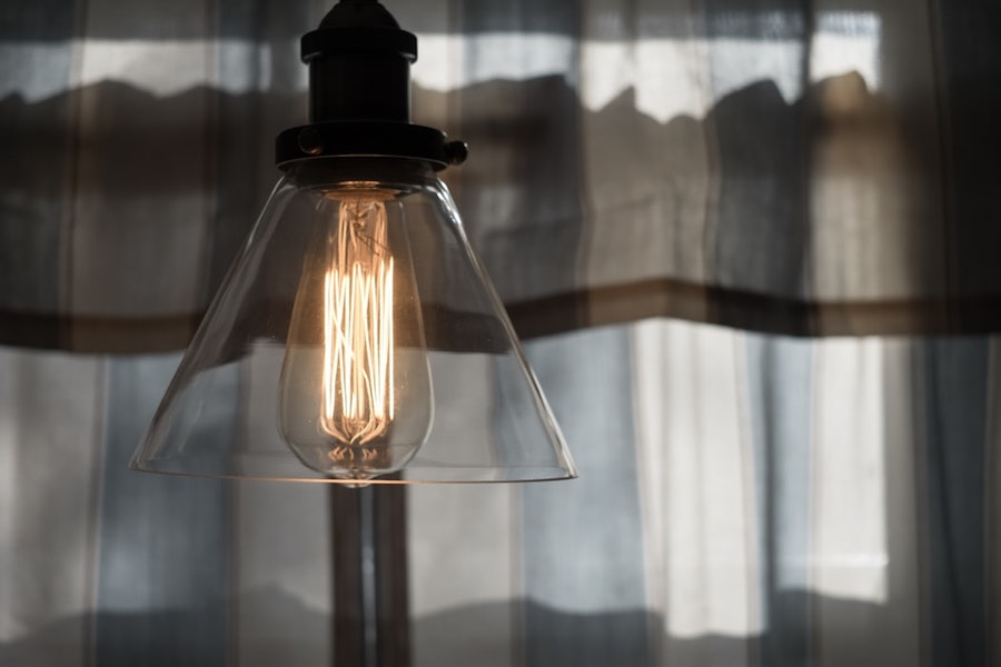 An Edison bulb hanging in an industrial space.