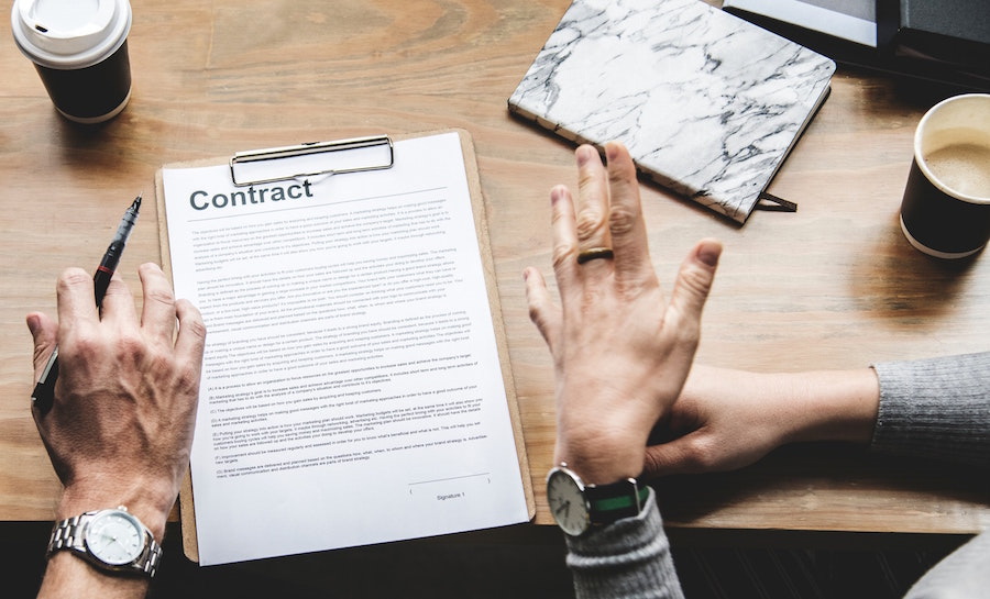 People signing a contract