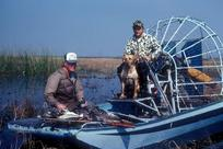 2 duck hunters in air boat