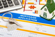 Mortgage application, keys and a calculator