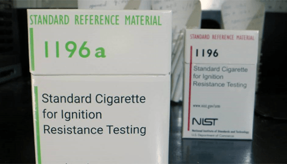 A box of cigarettes is labeled: Standard Cigarette for Ignition Resistance Testing
