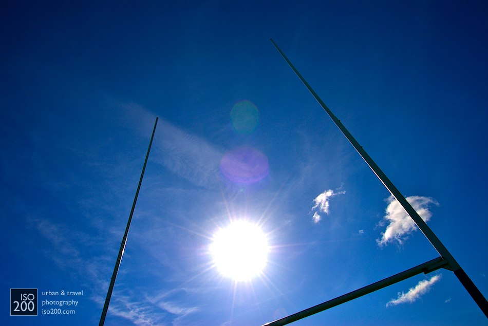 The sun through rugby goalposts on the grounds of Heriot's Rugby Club, Edinburgh.