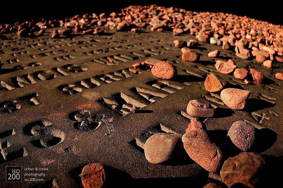 Pebbles scattered across a gravestone at Calton Hill Cemetery, Edinburgh.