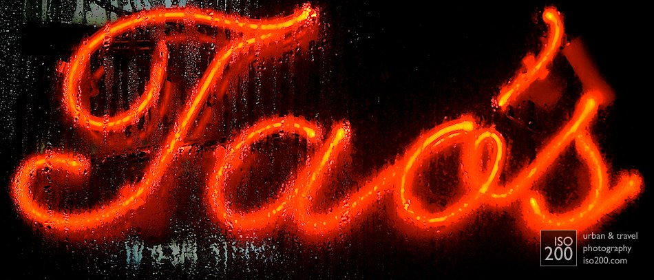 Water drips over Tao's Restaurant neon sign, Manhattan