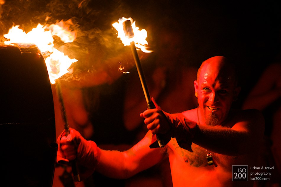 A red man with fire sticks beats a drum at the Edinburgh Beltane.