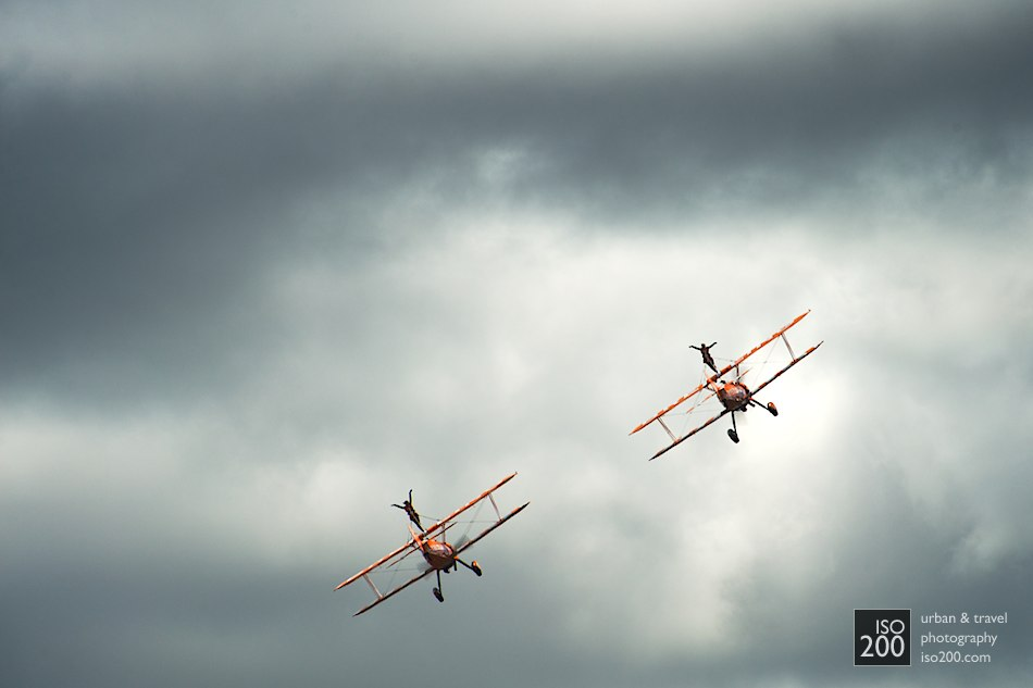 Two Breitling Wingwalkers from the AeroSuperBatics display team fly into the clouds at the 2011 East Fortune Museum of Flight Airshow.