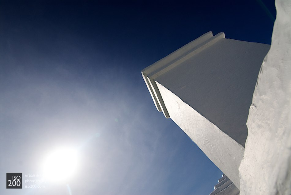 A typical Bermudian chimney against a blue sky.