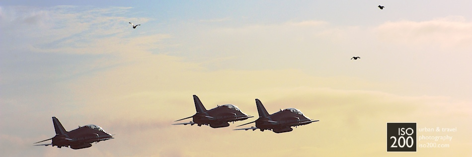 The Red Arrows fly towards the sunset at the end of the 2012 Diamond Jubilee Airshow at RAF Leuchars.