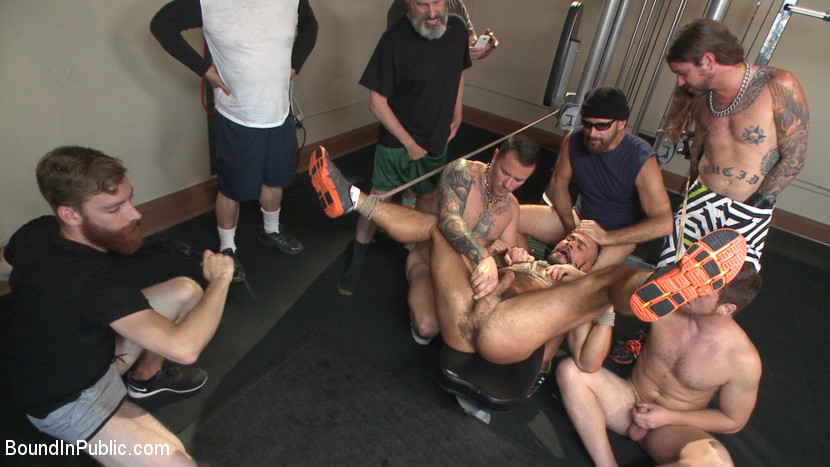 Horny gym goers dump their loads on a muscled gym rat - bondage