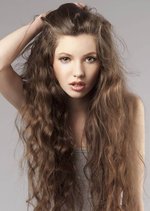 ultra lengthy locks stay interesting thanks to movement and volume from a combination of natural waves and curls