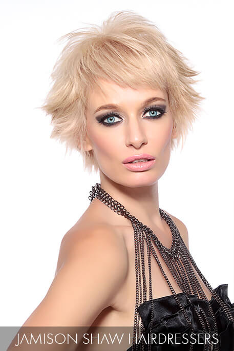 This chiseled short cut is bursting with life as the piecey bangs and perimeter blend effortlessly with the multidimensional ash-blonde hue.