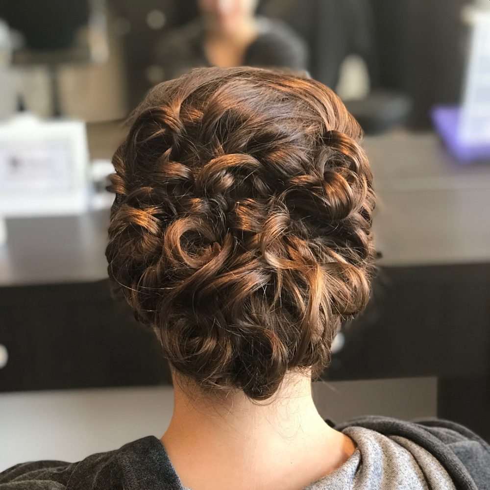 romantically braided curly updo romantically braided curly updo