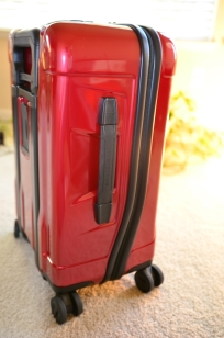 Red Briggs and Riley Torq carryon zippers curve
