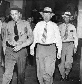 Murderer John Wallace (centre) and Sheriff Lamar Potts (on the right).