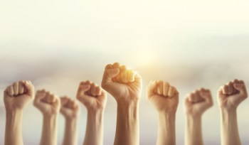 Your Revolution Won't Come In A Headline The Content Advisory Raised Fists