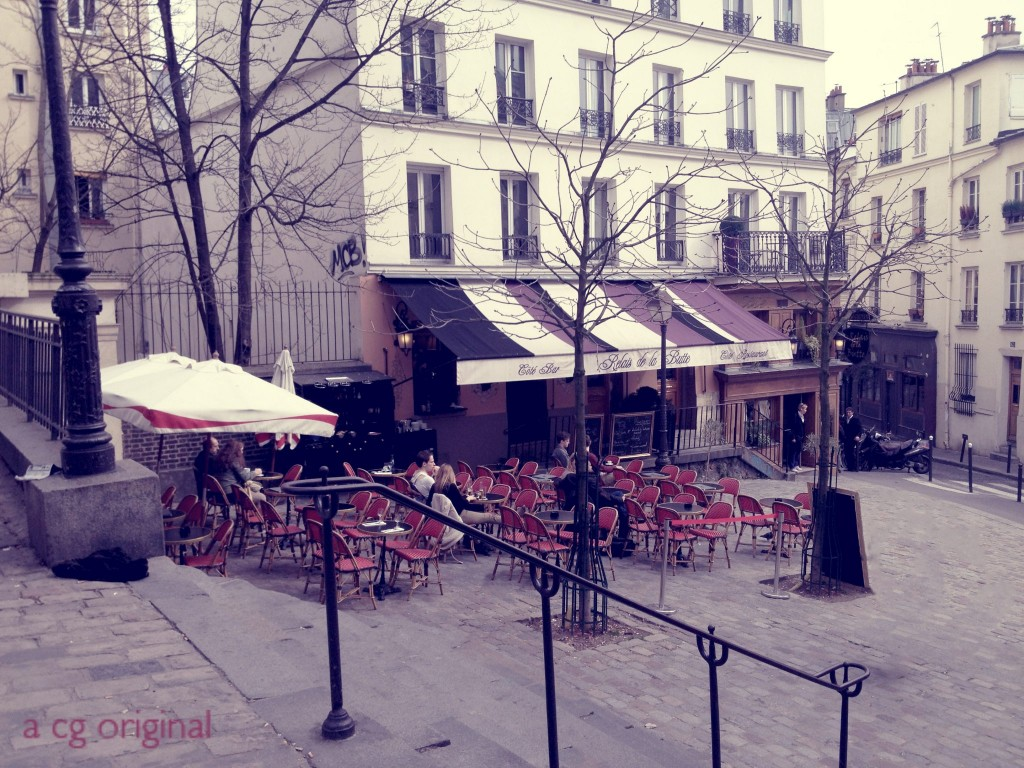 A contented gypsy original photo taken outside Relais De La Butte in Montmartre located in Paris