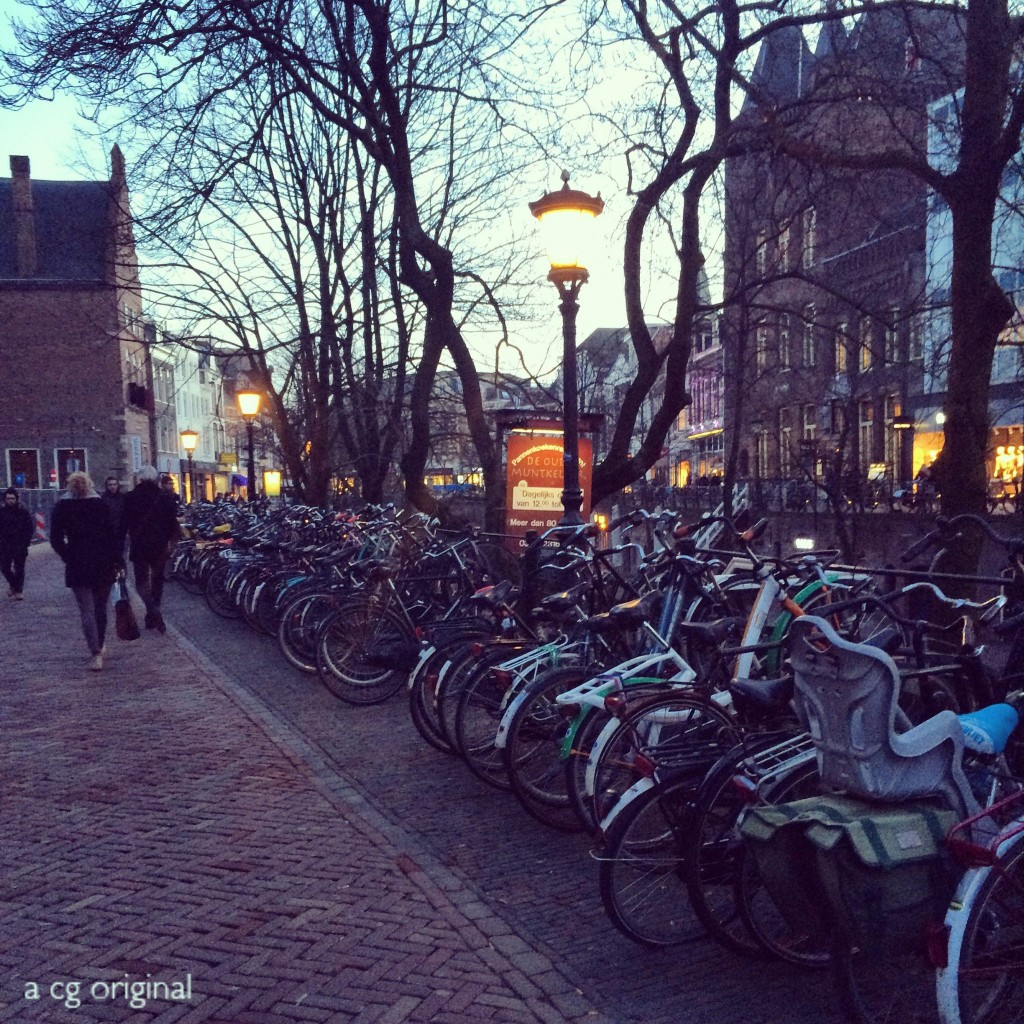 row of bicycles on a canal in utrecht