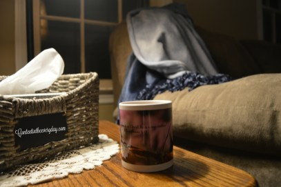 Fuzzy blanket, coffee cup, and tissues