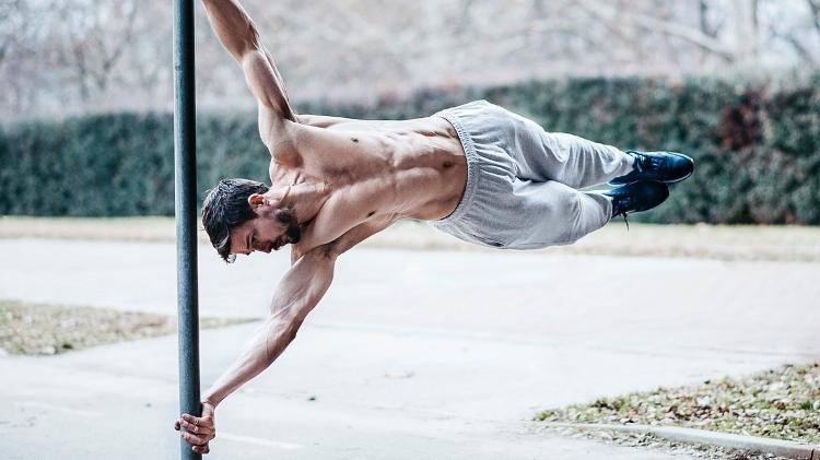 calisthenics, bodyweight training, human flag, human flag - iStock - iStock