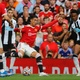 Cristiano Ronaldo tries to get past Newcastle during his United debut - Phil Noble/Reuters