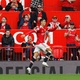 He returned!  Cristiano Ronaldo celebrates with his characteristic gesture after scoring his debut for United - Phil Noble/Reuters
