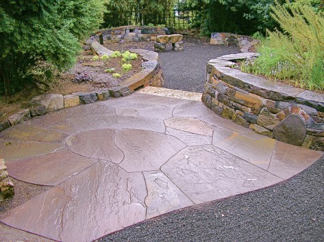 Eric Contey Stonework - DeGarmo patio with bench, walls, and stairs