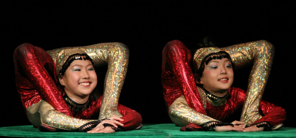 two performers in face frame