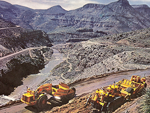 High above Salt River Canyon near Phoenix, Arizona, a TD30 push loads International 295 scrapers as they reshape a dangerous section of US.60 in 1965. The TD30 is equipped with a semi-U bulldozer, Ateco ripper and an amazing view!
