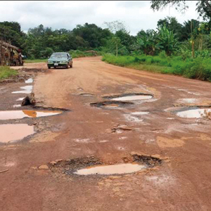 Potholed and cratered highway prior to reconstruction.