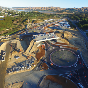 A closer view of the two new roundabouts on SH58 and the bridge which will carry TG over the interchange at Pauatahanui. The old SH58 is to the right.